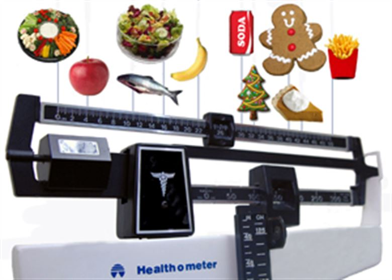 Scales with food on top, starting with healthy vegetables, fish and fruit and moving to soda, fries and sugar.