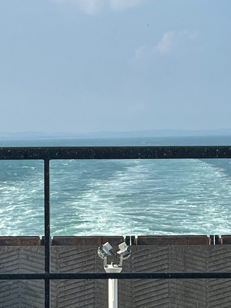The back of the ferry, land only just visible.