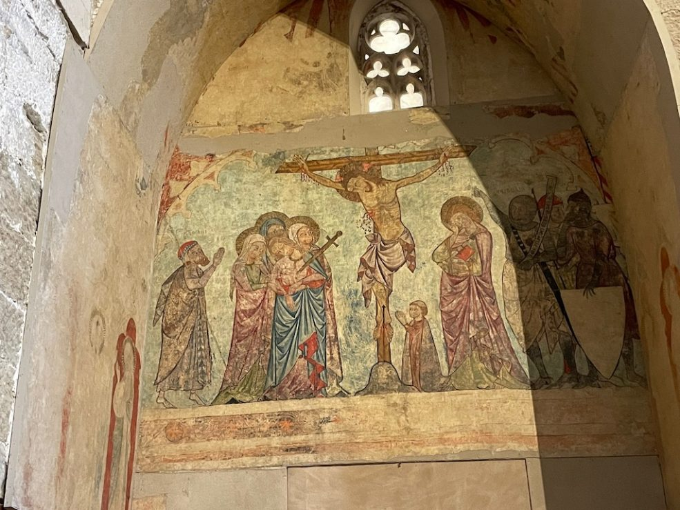 It's amazing that this beautiful mural still exists. Beautifully restored depiction of christ on the cross and others around him.