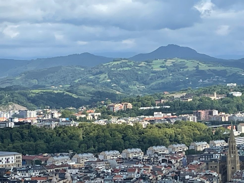 View from the top of the hill of the town and hills beyond